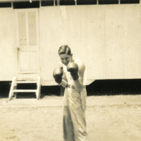 A soldier wearing boxing gloves