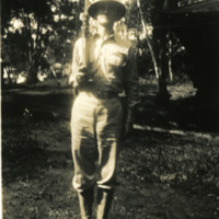 A soldier poses with a rifle in hand