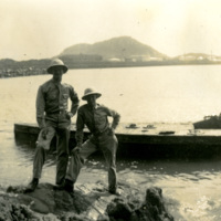 Two soldiers standing by the water
