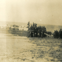 A large group of soldiers on the beach.