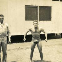 A man strikes a bodybuilding pose