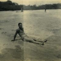 A man sitting on the beach