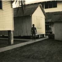 Soldier standing by buildings