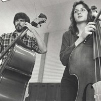 Music students playing basses