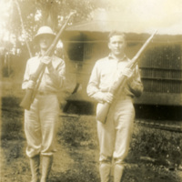 Two soldiers with rifles in their hands