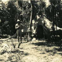 Two soldiers positioned near a tent