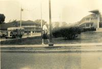 A woman walks on the sidewalk