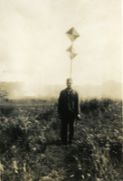 Daniel Klapproth stands in front of a sign