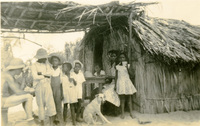 A group of people standing by a home