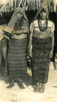 Two women pose for a photograph