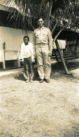 Daniel Klapproth with a young boy beside him