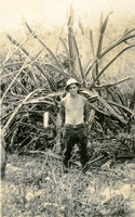 Shirtless Daniel Klapproth with plants
