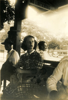 A young woman is seated on a bench