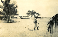 A child walking on the beach