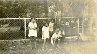Children by a fence