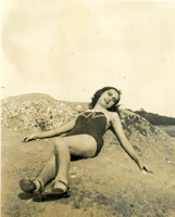 A woman in a dress lies down