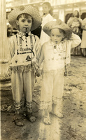 Two children pose for the camera