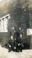 Daniel Klapproth poses with three other soldiers in uniform