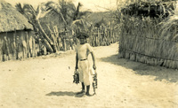 A child standing in a village